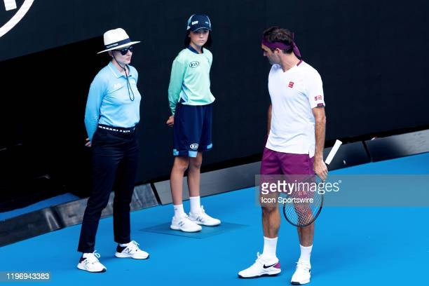 Roger Federer of Switzerland speaks with lineswoman after being penalised during quarterfinals of the Australian Open Tennis at Melbourne Park Tennis...