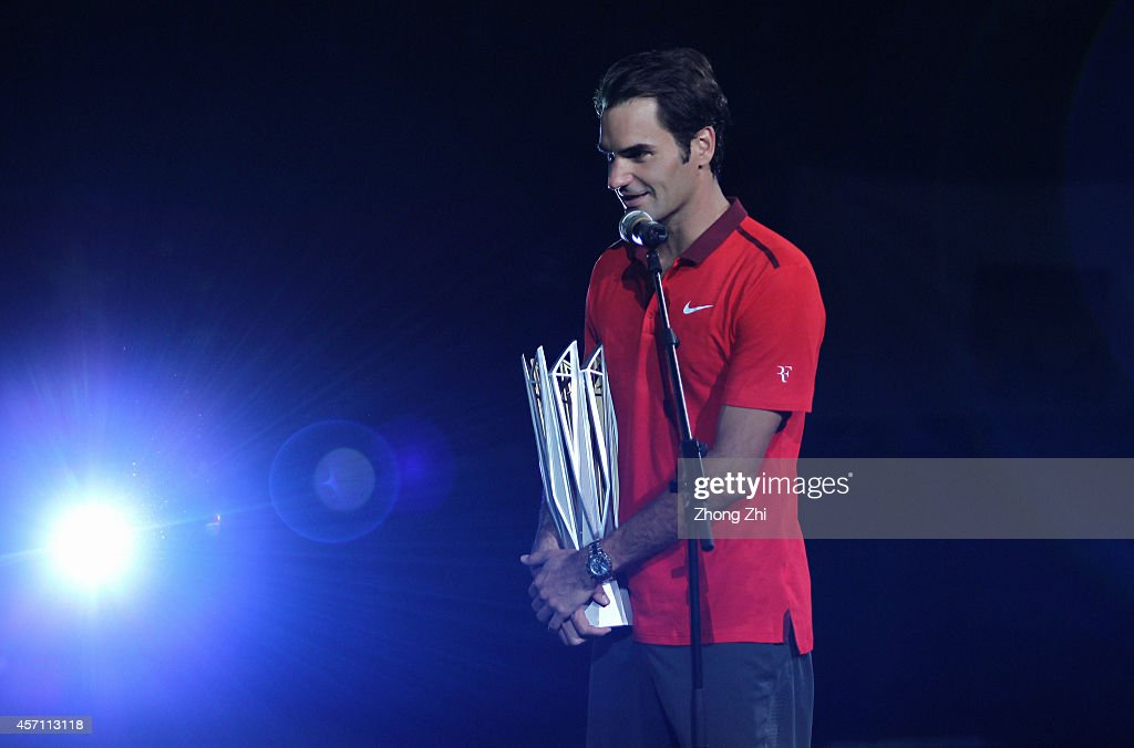 Roger Federer of Switzerland speeks with trophy after winning his final match against Gilles Simon of France during the day 8 of the Shanghai Rolex Masters at the Qi Zhong Tennis Center on October 12, 2014 in Shanghai, China.