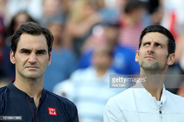 Roger Federer of Switzerland stands next to Novak Djokovic of Serbia after Djokovic won the mens final during Day 9 of the Western and Southern Open...