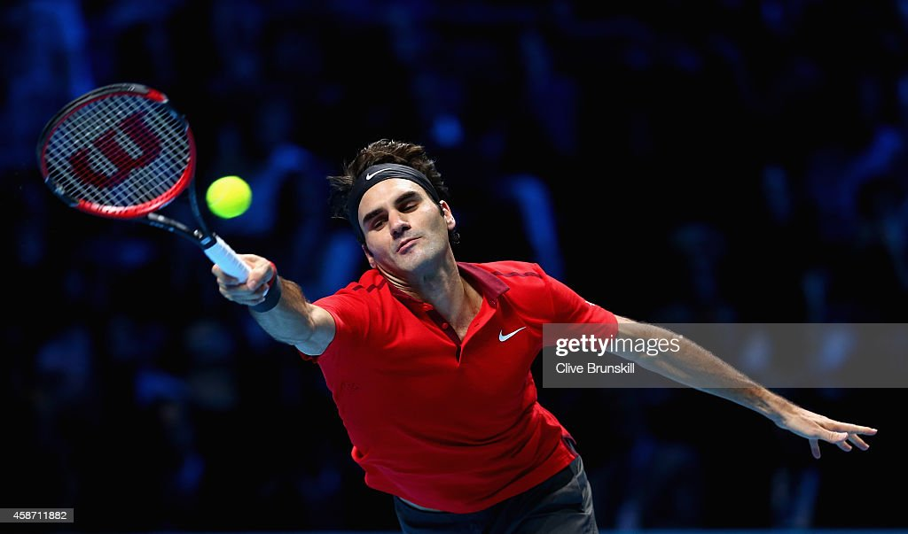 Roger Federer of Switzerland stretches to play a forehand against Milos Raonic of Canada during their round robin match during the Barclays ATP World Tour Finals at the O2 Arena on November 9, 2014 in London, England.