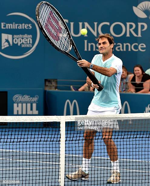 Roger Federer of Switzerland swings an oversized racket to hit a return during an event ahead of the start of the Brisbane International tennis...