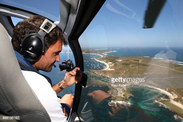 Roger Federer of Switzerland takes a photo from a helicopter onroute to Rottnest Island ahead of the 2018 Hopman Cup on December 28 2017 in Perth...