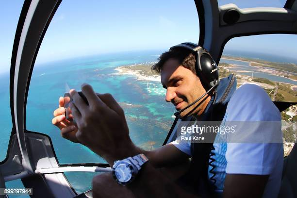 Roger Federer of Switzerland takes a selfie from a helicopter onroute to Rottnest Island ahead of the 2018 Hopman Cup on December 28 2017 in Perth...