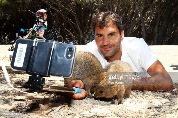 Roger Federer of Switzerland takes a selfie with Quokka's at Rottnest Island ahead of the 2018 Hopman Cup on December 28 2017 in Perth Australia