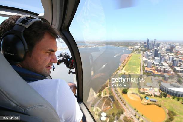 Roger Federer of Switzerland takes in the Perth CBD from a helicopter onroute to Rottnest Island ahead of the 2018 Hopman Cup on December 28 2017 in...