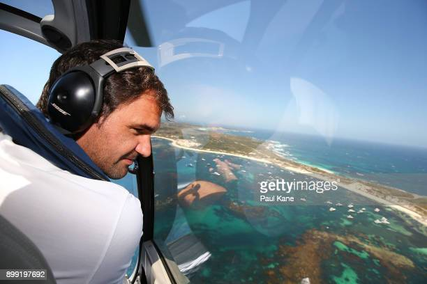 Roger Federer of Switzerland takes in the view from a helicopter onroute to Rottnest Island ahead of the 2018 Hopman Cup on December 28 2017 in Perth...