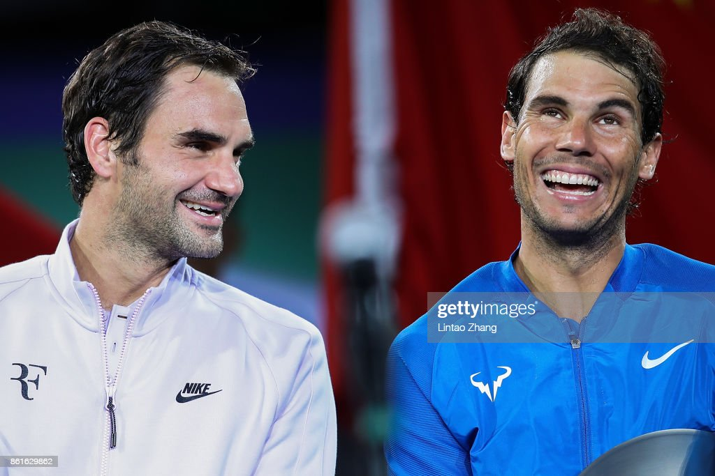 Roger Federer of Switzerland talk with Rafael Nadal of Spain during the award ceremony after the Men's singles final mach on day eight of 2017 ATP Shanghai Rolex Masters at Qizhong Stadium on October 15, 2017 in Shanghai, China.