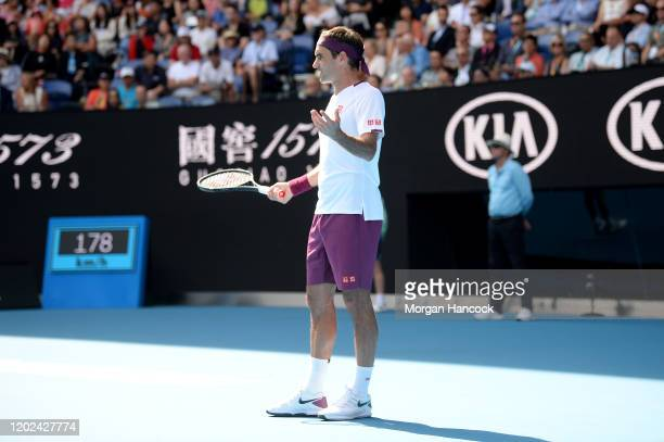 Roger Federer of Switzerland talks to chair umpire Marijana Veljovic during his Men's Singles Quarterfinal match against Tennys Sandgren of the...