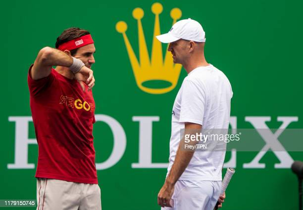 Roger Federer of Switzerland talks to his coach Ivan Ljubicic during a practice session with Marin Cilic of Croatia at the Rolex Shanghai Masters at...