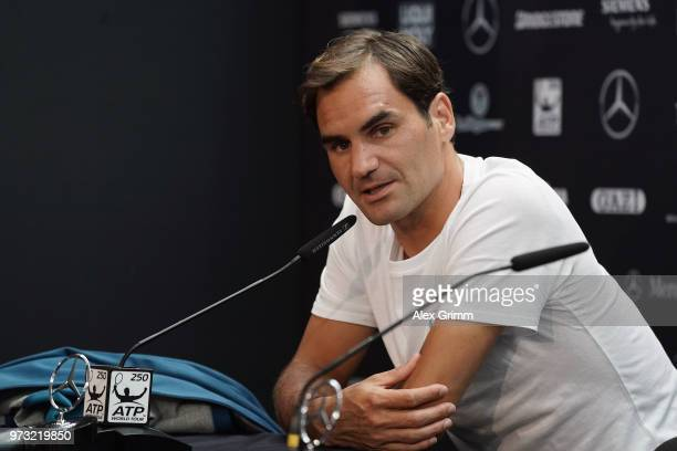 Roger Federer of Switzerland talks to the media after winning his match against Mischa Zverev of Germany during day 3 of the Mercedes Cup at...