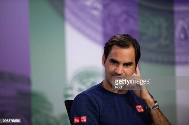 Roger Federer of Switzerland talks to the media at a press conference after losing his Men's Singles QuarterFinals match against Kevin Anderson of...