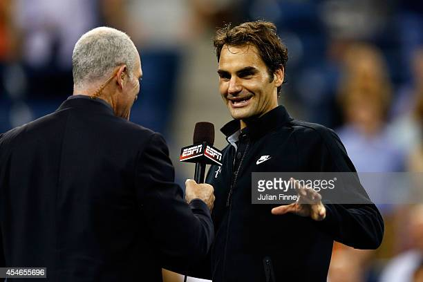 Roger Federer of Switzerland talks with Brad Gilbert after defeating Gael Monfils of France during their men's singles quarterfinal match on Day...