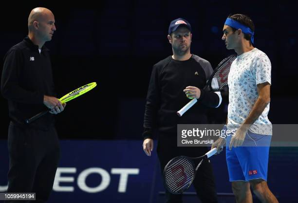 Roger Federer of Switzerland talks with his coach Ivan Ljubcic and Severin Luthi during a training session prior to the Nitto ATP World Tour Finals...