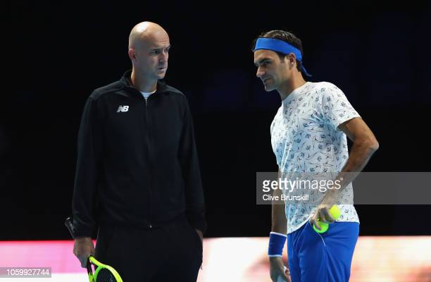Roger Federer of Switzerland talks with his coach Ivan Ljubcic during a training session prior to the Nitto ATP World Tour Finals at O2 Arena on on...