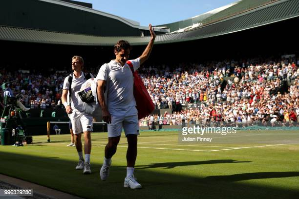 Roger Federer of Switzerland thanks the crowd after losing his Men's Singles QuarterFinals match against Kevin Anderson of South Africa on day nine...