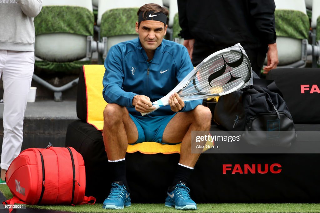 Roger Federer of Switzerland unpacks his new racket during day 3 of the Mercedes Cup at Tennisclub Weissenhof on June 13, 2018 in Stuttgart, Germany. Roger Federer debuts his new Wilson Pro Staff RF 97 Autograph racket at the 2018 Mercedes Cup in Stuttgart. The white and black design of the racket was inspired by the classic tuxedo, or dinner suit, and Federer's timeless and elegant sense of style.