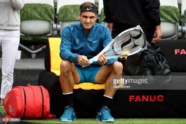 Roger Federer of Switzerland unpacks his new racket during day 3 of the Mercedes Cup at Tennisclub Weissenhof on June 13 2018 in Stuttgart Germany...