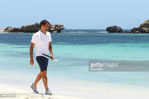 Roger Federer of Switzerland walks along the beach after arriving at Rottnest Island ahead of the 2018 Hopman Cup on December 28 2017 in Perth...