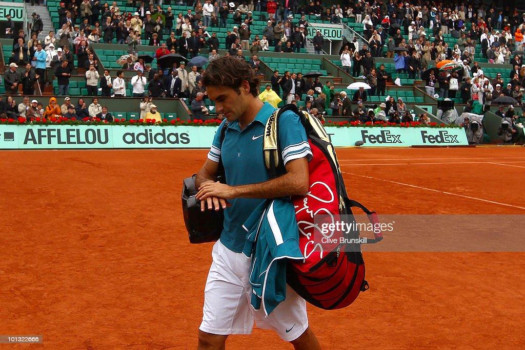 Roger Federer of Switzerland walks off after losing the men's singles quarter final match between Robin Soderling of Sweden and Roger Federer of Switzerland at the French Open on day ten of the French Open at Roland Garros on June 1, 2010 in Paris, France.