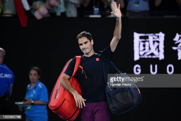 Roger Federer of Switzerland walks off court after losing his Men's Singles Semifinal match against Novak Djokovic of Serbia on day eleven of the...