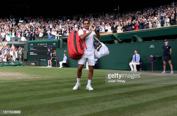 Roger Federer of Switzerland walks off court after losing his men's Singles Quarter Final match against Hubert Hurkacz of Poland on Day Nine of The...