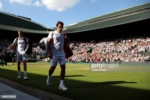 Roger Federer of Switzerland walks off No1 court after losing his Men's Singles QuarterFinals match against Kevin Anderson of South Africa on day...