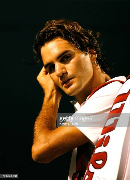 Roger Federer of Switzerland walks off the court after losing to Gilles Simon of France during the Rogers Cup at the Rexall Centre at York University...