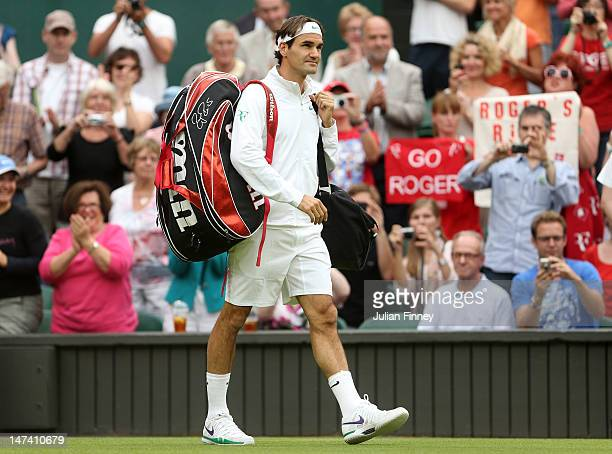 Roger Federer of Switzerland walks on court ahead of his Gentlemen's Singles third round match against Julien Benneteau of France on day five of the...