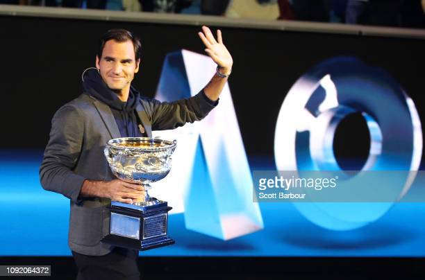Roger Federer of Switzerland walks on stage with the Norman Brookes Challenge Cup during the Official Draw ahead of the 2019 Australian Open at...