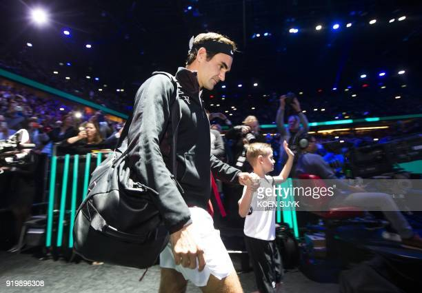 Roger Federer of Switzerland walks onto court ahead of his men's singles final against Grigor Dimitrov of Bulgaria for the ABN AMRO World Tennis...