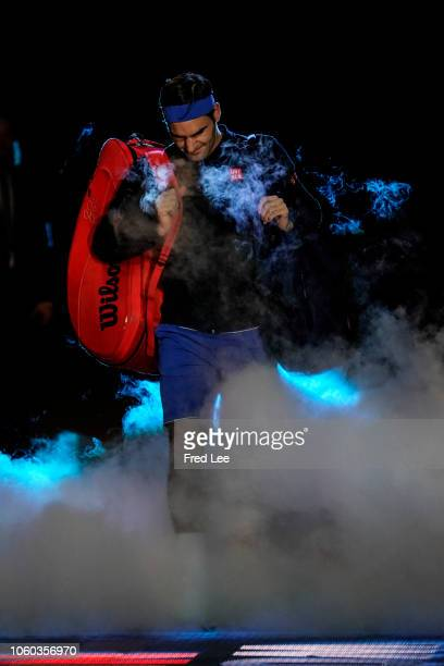 Roger Federer of Switzerland walks onto the court ahead of his match against Kei Nishikori of Japan during Day One of the Nitto ATP Finals at The O2...