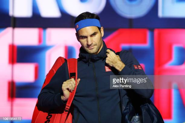 Roger Federer of Switzerland walks onto the court before his round robin match against Kevin Anderson of South Africa during Day Five of the Nitto...