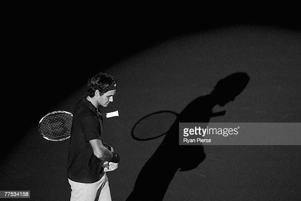 Roger Federer of Switzerland walks onto the court before his Semi Final singles match against Ivo Karlovic of Croatia during Day Five of the ATP...