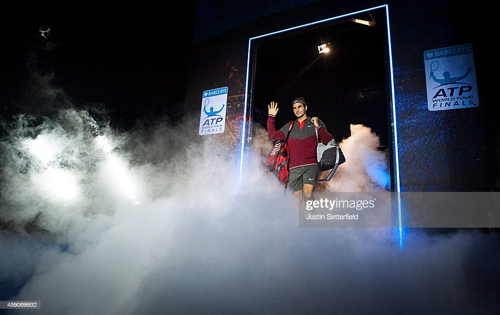 Roger Federer of Switzerland walks onto to the court for his match in the round robin singles against Kei Nishikori of Japan on day three of the Barclays ATP World Tour Finals at the O2 Arena on November 11, 2014 in London, England.