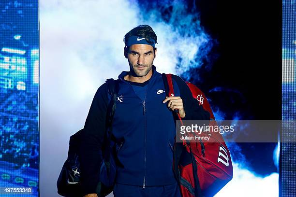 Roger Federer of Switzerland walks out ahead of men's singles match against Novak Djokovic of Serbia during day three of the Barclays ATP World Tour...