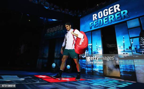 Roger Federer of Switzerland walks out for his opening singles round robin match against Jack Sock of the United States during the Nitto ATP World...