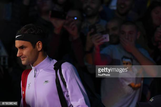 Roger Federer of Switzerland walks out on court for his third and final round robin match against Marin Cilic of Croatia during the Nitto ATP World...