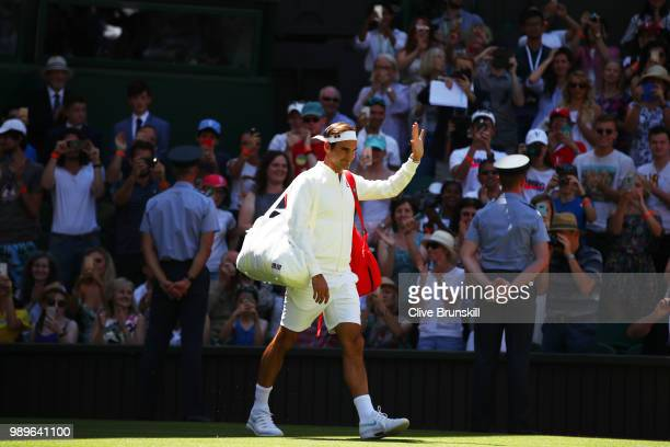 Roger Federer of Switzerland walks out onto the court ahead of his Men's Singles first round match against Dusan Lajovic of Serbia on day one of the...