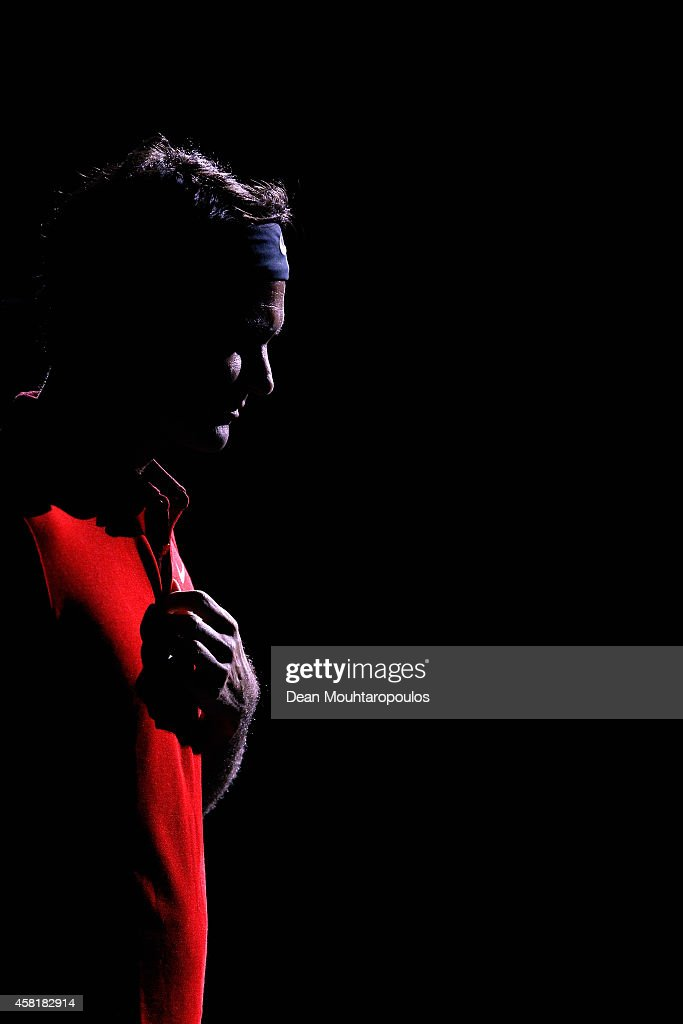 Roger Federer of Switzerland walks out to play his quarterfinal match against Milos Raonic of Canada during day 5 of the BNP Paribas Masters held at the at Palais Omnisports de Bercy on October 31, 2014 in Paris, France.