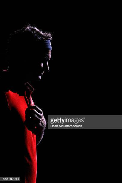 Roger Federer of Switzerland walks out to play his quarterfinal match against Milos Raonic of Canada during day 5 of the BNP Paribas Masters held at...
