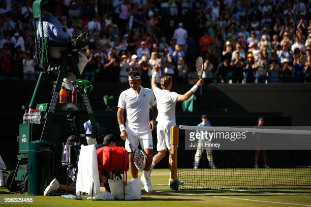 Roger Federer of Switzerland walks to his chair after losing his Men's Singles QuarterFinals match against Kevin Anderson of South Africa on day nine...