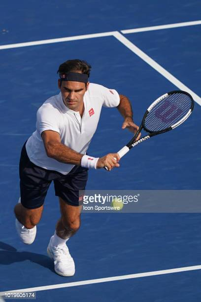 Roger Federer of Switzerland watches a shot go by in the championship match with Novak Djokovic of Serbia during the Western Southern Open singles...