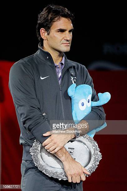 Roger Federer of Switzerland watches as Andy Murray of Great Britain is interviewed after the final on day seven of the 2010 Shanghai Rolex Masters...
