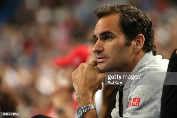 Roger Federer of Switzerland watches the women's singles match between Belinda Bencic of Switzerland and Maria Sakkari of Greece during day six of...