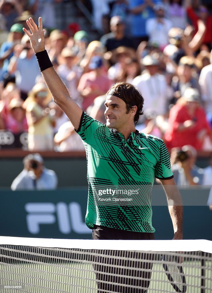 Roger Federer of Switzerland waves at his family as he celebrates after defeating Stanislas Wawrinka of Switzerland in the mens final during day fourteen of the BNP Paribas Open at Indian Wells Tennis Garden on March 19, 2017 in Indian Wells, California.