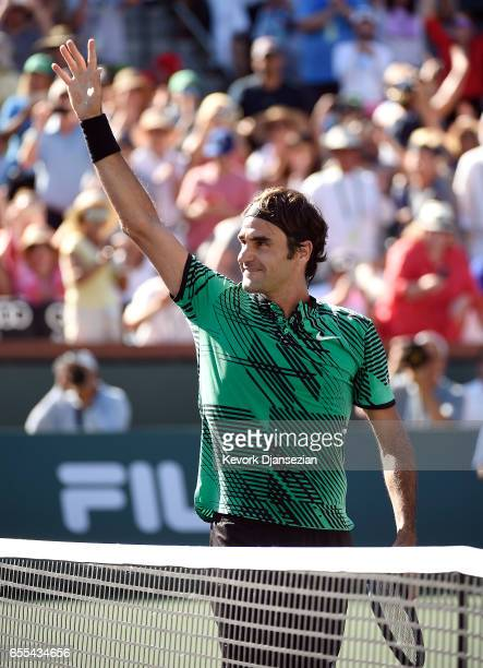 Roger Federer of Switzerland waves at his family as he celebrates after defeating Stanislas Wawrinka of Switzerland in the mens final during day...