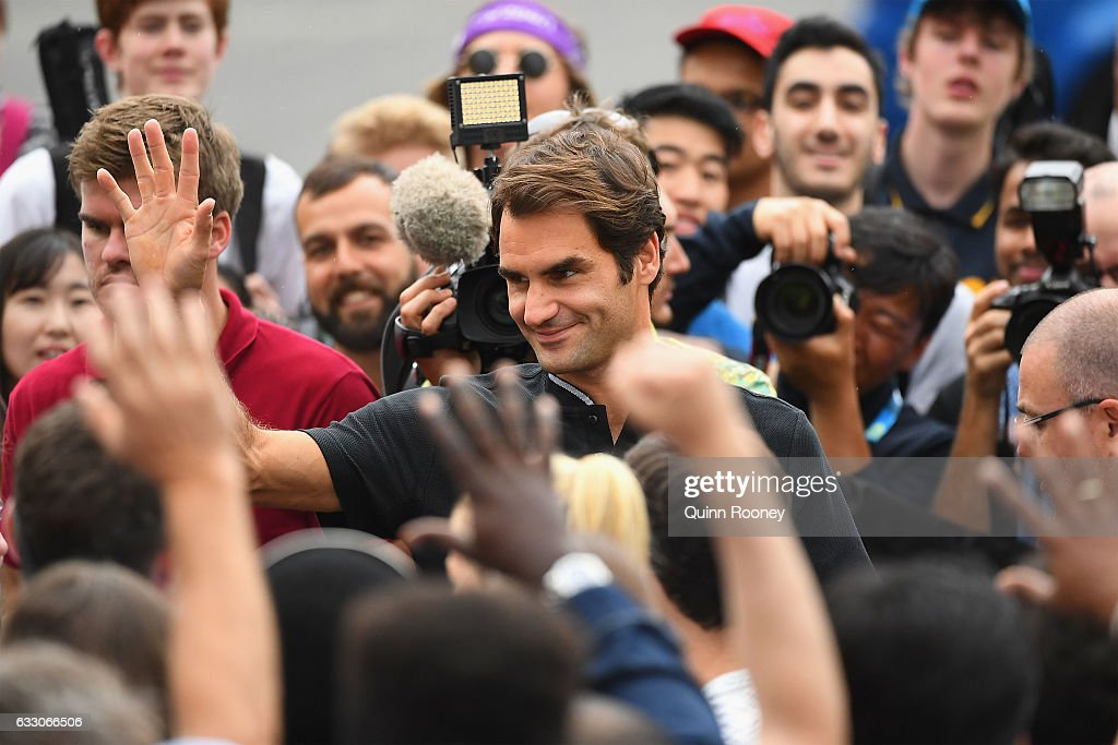 Roger Federer of Switzerland waves good bye to fans after posing with the Norman Brookes Challenge Cup after winning the 2017 Australian Open Men's Singles Final, on January 30, 2017 in Melbourne, Australia.