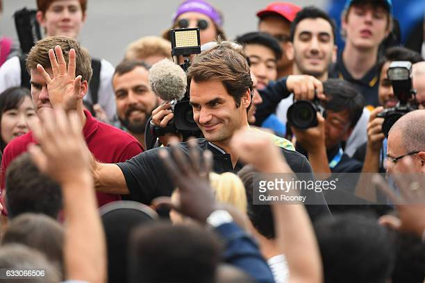 Roger Federer of Switzerland waves good bye to fans after posing with the Norman Brookes Challenge Cup after winning the 2017 Australian Open Men's...