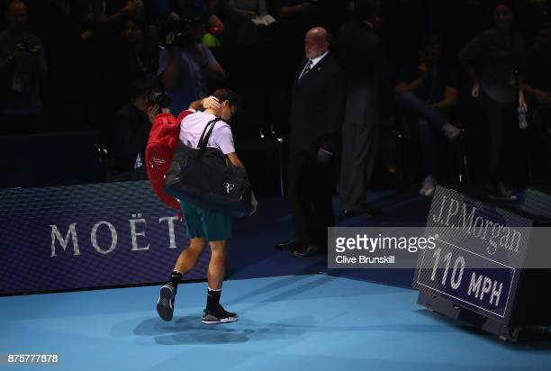 Roger Federer of Switzerland waves goodbye to the crowd after his three set defeat by David Goffin of Belgium in their semi final match the Nitto ATP...