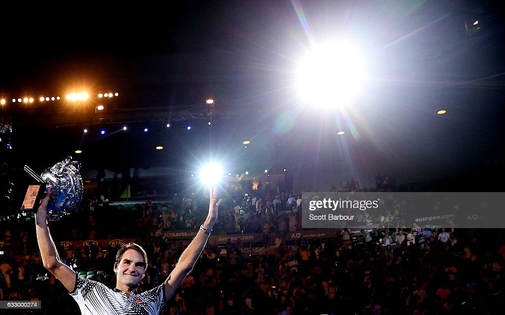 Roger Federer of Switzerland waves to fans in the crowd as he does a lap of honour with the Norman Brookes Challenge Cup after winning the Men's Final match against Rafael Nadal of Spain on day 14 of the 2017 Australian Open at Melbourne Park on January 29, 2017 in Melbourne, Australia.
